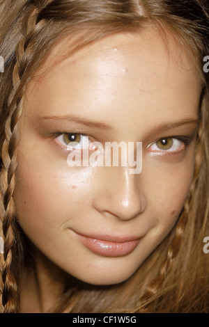 Backstage at Anne Klein New York Ready to Wear Spring Summer Model facing camera smiling long auburn hair two plaits - Stock Photo