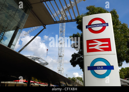 Underground, overground and DLR (Docklands Light Railway) sign outside Stratford station. Stratford Regional Station - Stock Photo