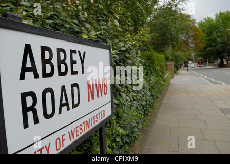 Abbey Road sign and view down Abbey Road towards the famous recording studios. Abbey Road studios is the location - Stock Photo