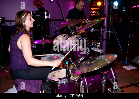 Drummer Ann Batty and bassist Doug Long of the After Hours Blues Band performing live at Mangos nightclub in Dundee - Stock Photo