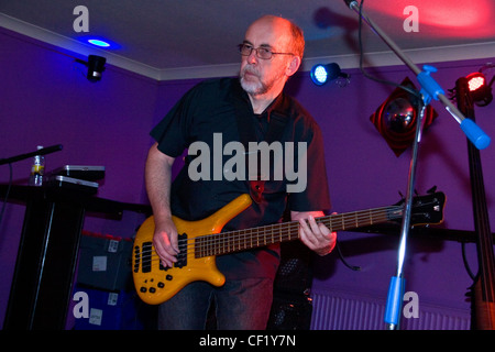 Bassist Doug Long of the After Hours Blues Band performing live at Mangos nightclub in Dundee 2011,UK - Stock Photo