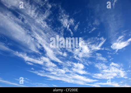White wispy clouds in a blue summer sky - Stock Photo