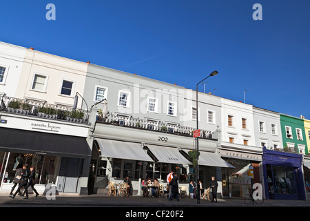 A row of shops and restaurants in Westbourne Grove. - Stock Photo