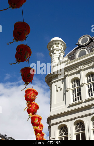Lanterns hanging above the street in London's Chinatown. - Stock Photo