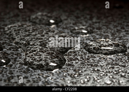 Water drops on metal surface - still life - Stock Photo