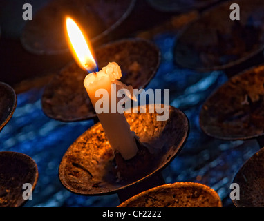 Burning candle in St Mary's Church, Great Budworth, Near Northwich and Antrobus , Cheshire England, United Kingdom - Stock Photo