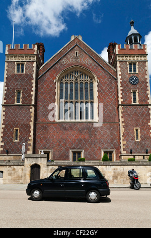 A black London taxi cab outside Lincoln's Inn, one of four Inns of Court in London. - Stock Photo