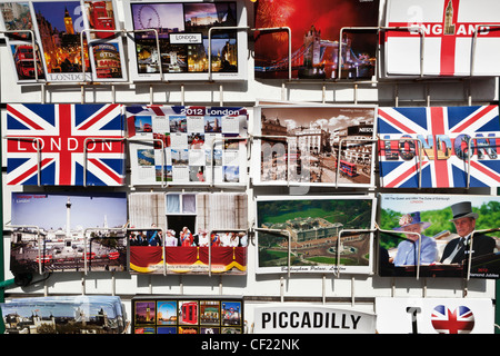 Souvenir postcards of London on display in a rack. - Stock Photo