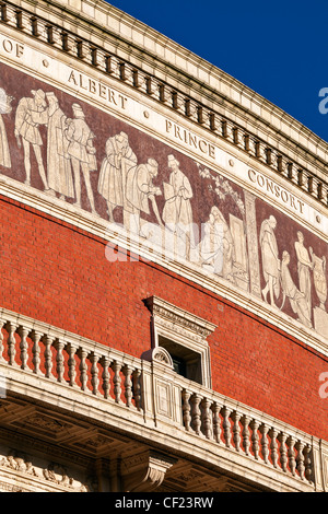 Exterior of the Royal Albert Hall, a concert hall opened by Queen Victoria in 1871. A mosaic frieze depicting 'The - Stock Photo