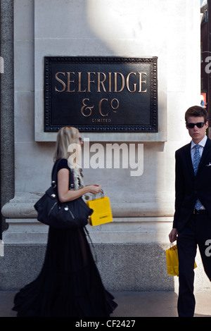 Shoppers outside Selfridges department store in Oxford Street. - Stock Photo