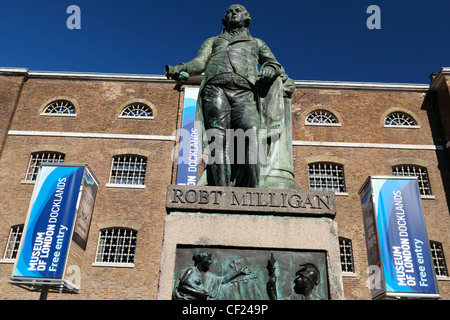 A statue of Robert Milligan (1746 – 1809), a prominent English merchant and ship-owner, the driving force - Stock Photo