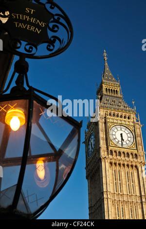 A lantern hanging outside St Stephens Tavern opposite Big Ben. - Stock Photo