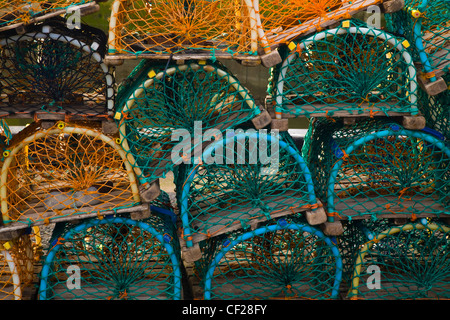 Sea fishing lobster pots stacked in the harbour of Eyemouth. - Stock Photo