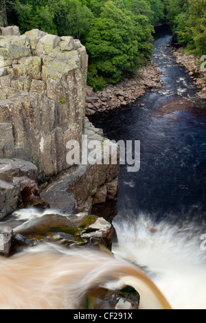 The River Tees cascading down the High Force waterfall in County Durham. - Stock Photo