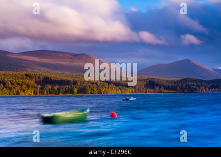 A stormy evening on Loch Morlich with the Cairngorm Mountain Range in the distance. - Stock Photo