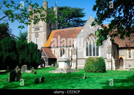 View across churchyard to St Mary the Virgin church at Hambleden Village. The name is Anglo Saxon in origin and - Stock Photo