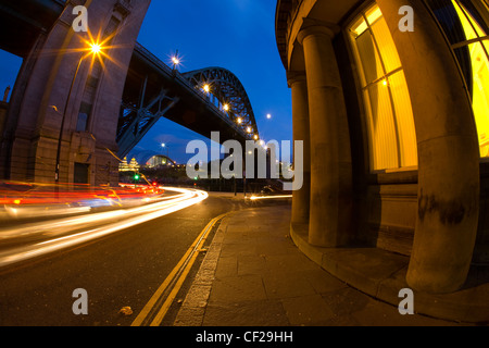Rush hour traffic near the Tyne Bridge and the Guildhall. - Stock Photo