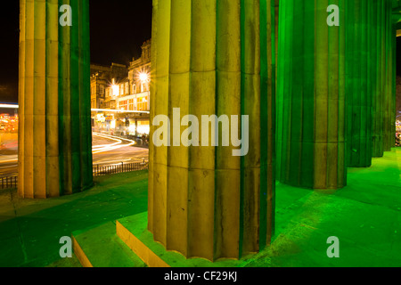 Illuminated facade of the Royal Scottish Academy on the busy Princes Street in Edinburgh. - Stock Photo