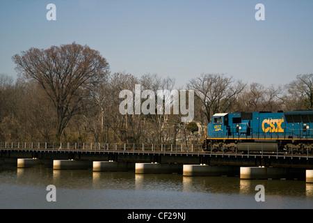 CSX locomotive 4817 on a railroad bridge crossing over the Anacostia River near Historic Congressional Cemetery - Stock Photo