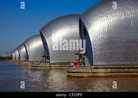 The Thames Barrier, the world's second largest movable flood barrier, on the River Thames. - Stock Photo