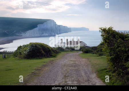 Looking east from Cuckmere Haven towards the chalk cliffs of the Seven Sisters. - Stock Photo