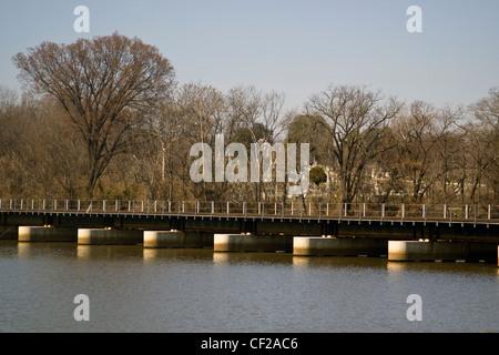 A CSX railroad bridge crossing over the Anacostia River near Historic Congressional Cemetery in Washington DC - Stock Photo