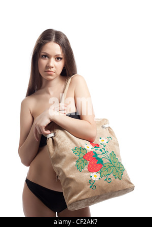 23df32b1985e0 Young woman in black bikini posing with funny beach bag isolated - Stock  Photo