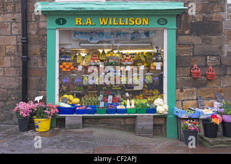 Fruit and vegetables on display in the window of R. A. Willison, a traditional greengrocer in Whitby. - Stock Photo