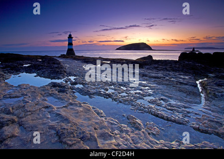Penmon Lighthouse, also known as Menai Lighthouse, at the north entrance to the Menai Strait opposite Puffin Island - Stock Photo