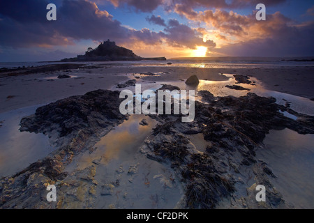 Sunset over St Michaels Mount in Mount's Bay from the beach at Marazion. - Stock Photo