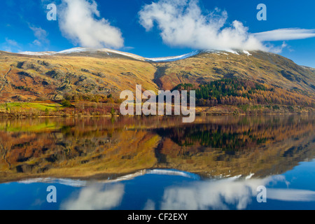 Lakeland hills reflected upon the still face of the Thirlmere Reservoir in the Lake District National Park. - Stock Photo