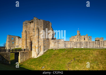 Warkworth Castle, a 12th century stone motte and bailey fortress located on a defensive mound in the village of - Stock Photo