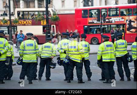A cordon of Metropolitan Police Officers on duty in central London. - Stock Photo