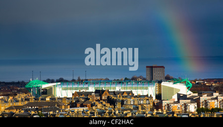 A rainbow in the Firth of Forth over Hibernian Football Club's stadium at Easter Road in the Leith area of Edinburgh. - Stock Photo