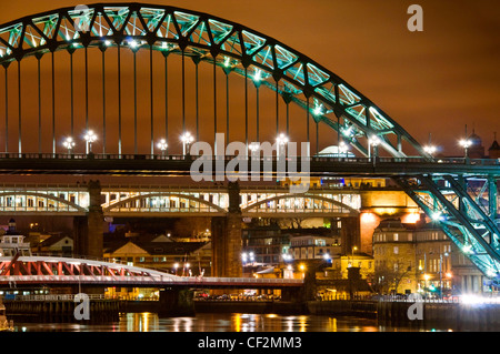 Evening view of the famous Tyne Bridges spanning the River Tyne to link Newcastle upon Tyne on the northern side - Stock Photo