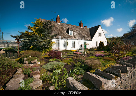 A country cottage and garden in the picturesque village of Etal in the north east of England, close to the border - Stock Photo