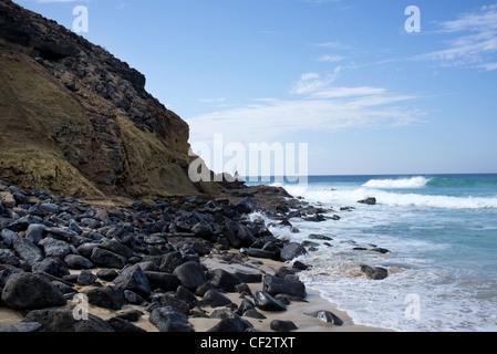man fishing on the rocks fuerteventura - Stock Photo