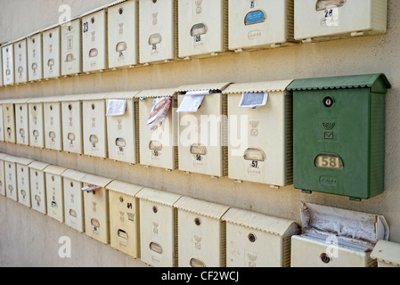 mailboxes on a wall - Stock Photo