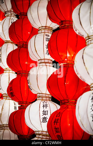 Red And White Chinese Lanterns With 'good Luck' In The Chinese Language; Beijing China - Stock Photo