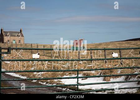 Religious text on farm gate in the Cabrach, Morayshire. - Stock Photo