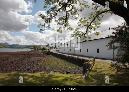 Talisker Whisky Distillery at Carbost on the shores of Loch Harport with dramatic views of the Cuillins on the Isle of Skye.