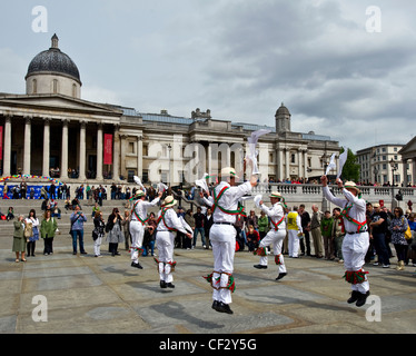 Dolphin Morris Men dancing at the Westminster Day of Dance in Trafalgar Square. - Stock Photo