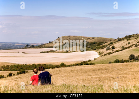 Chiltern Hills - on Pitstone Hill - woman and child enjoying view to Ivinghoe Beacon high summer day - Stock Photo