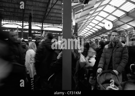 Saint Lazare station in Paris, on a day of strike.  This are two pictures in one, a  visual solution to improve - Stock Photo