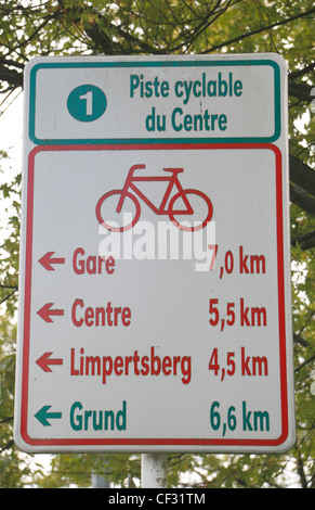 Typical street sign showing cycle routes and distances in Kirchberg, Luxembourg city, Luxembourg. - Stock Photo