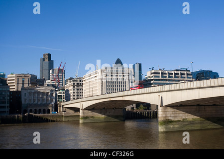 London Bridge connecting Southwark on the South Bank and the City of London on the North Bank of the River Thames. - Stock Photo