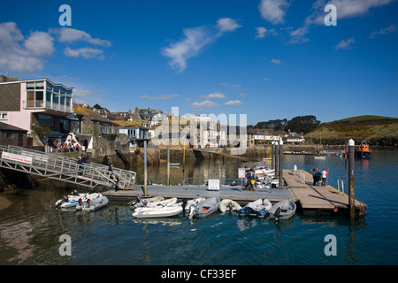 Small boats moored to Whitestrand Pontoon in Salcombe Harbour in Devon's most southerly town. - Stock Photo
