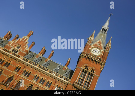 The Victorian architecture and clock tower of St Pancras Station in London. - Stock Photo