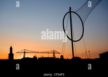 Temenos by Anish Kapoor at Middlehaven Dock and Middlesbrough's iconic Tees Transporter Bridge. - Stock Photo
