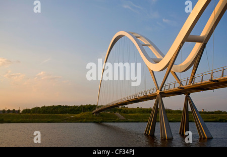 The Infinity Bridge, a pedestrian and cycle bridge across the River Tees. The bridge is named after the infinity symbol formed b Stock Photo
